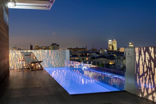 The swimming pool at or near Gaudi Hotel