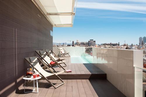 A balcony or terrace at Gaudi Hotel