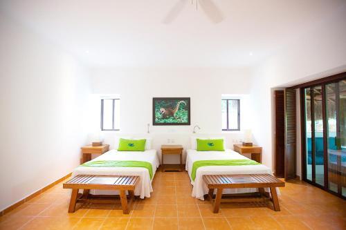 A bed or beds in a room at Hotel Rancho Encantado