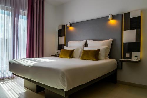 Cama o camas de una habitación en Hotel Valentina