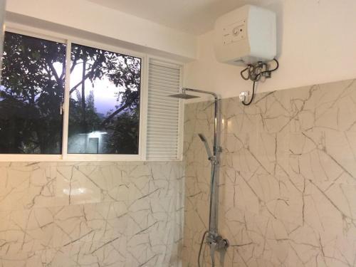 Ein Badezimmer in der Unterkunft Selyna Sky Terrace