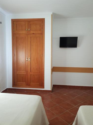 A television and/or entertainment center at Apartamentos Los Mellizos