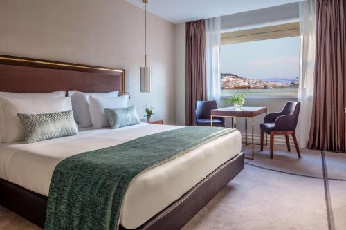A bed or beds in a room at Tivoli Avenida Liberdade Lisboa – A Leading Hotel of the World