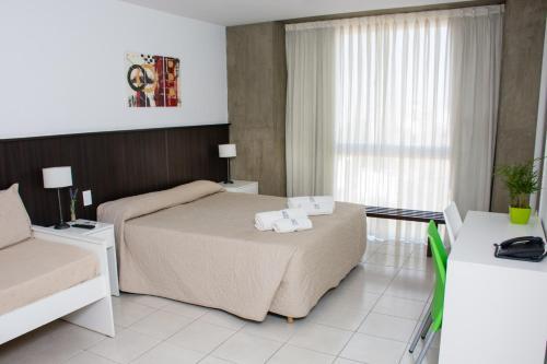 Una cama o camas en una habitación de Torre Potosi Departamentos
