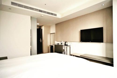 德爾芙快捷酒店 房間的床