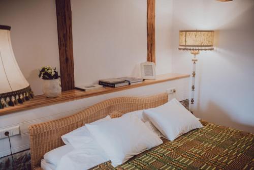 A bed or beds in a room at Fotogrāfa Apartamenti