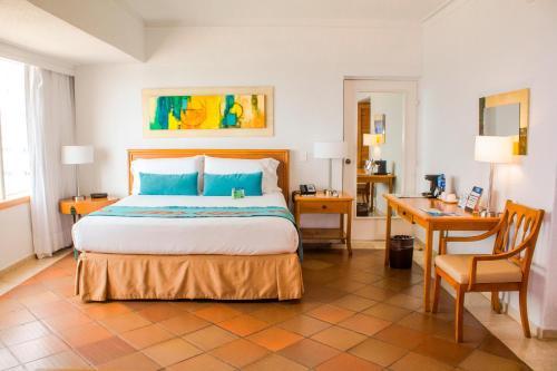 Cama o camas de una habitación en Hotel Almirante Cartagena Colombia