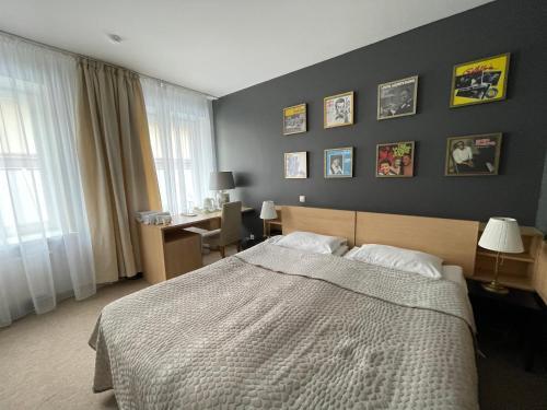 Un ou plusieurs lits dans un hébergement de l'établissement Jazz Hotel Navalis, Tubinas Hotels