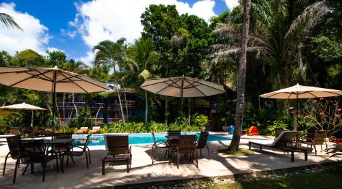 A piscina localizada em Atmosphera Pousada ou nos arredores
