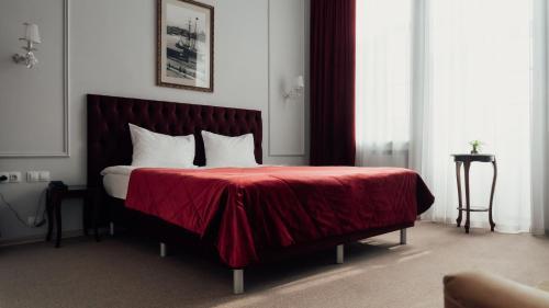 Кровать или кровати в номере Отель Марель