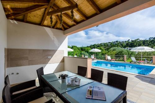 A view of the pool at Apartments Mali Paradiso or nearby