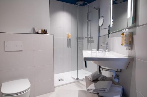 Ein Badezimmer in der Unterkunft Mercure Antwerp City Centre