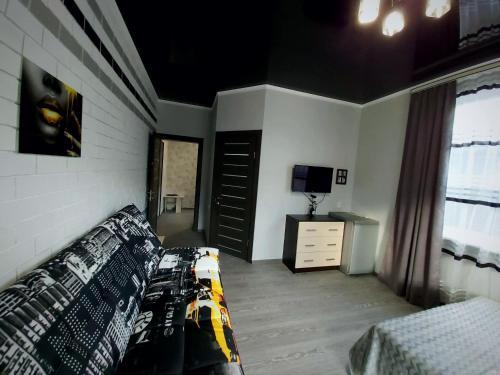 Телевизор и/или развлекательный центр в Zhara Apartment