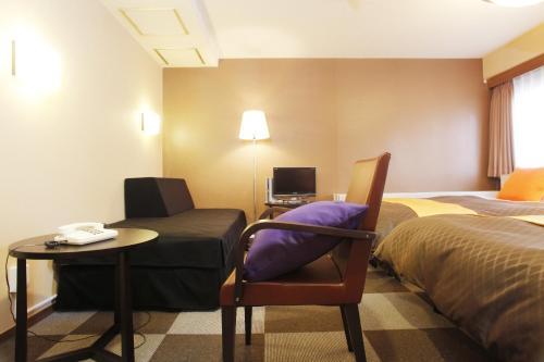 A television and/or entertainment center at Hotel 1-2-3 Nagoya Marunouchi