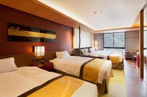 Letto o letti in una camera di Gifu Grand Hotel