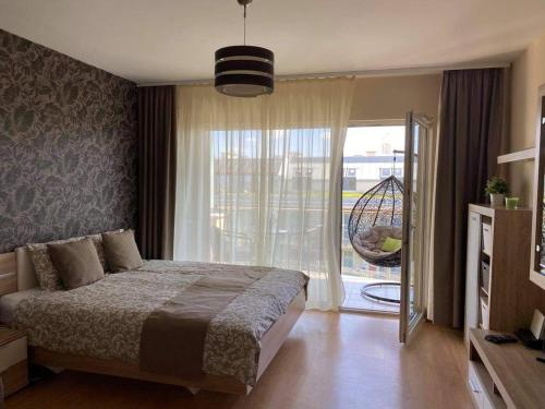 A bed or beds in a room at Lake and Spa Apartman