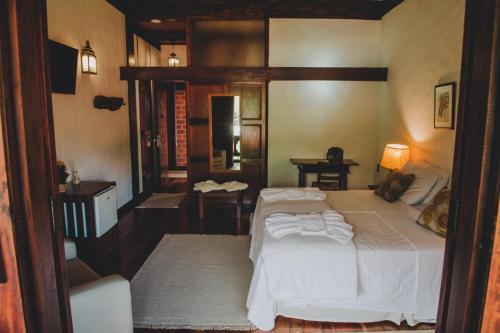 Cama ou camas em um quarto em Pousada Pedra Azul