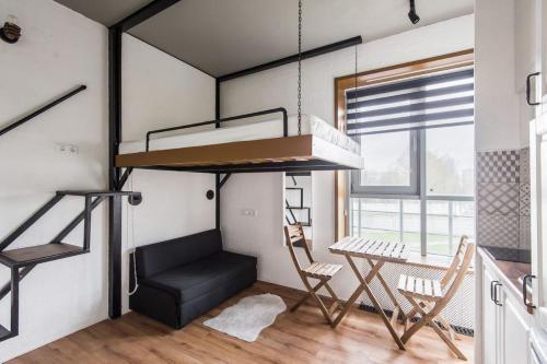 Двухъярусная кровать или двухъярусные кровати в номере Апартаменты на улице Саморы Машела, 2А-1