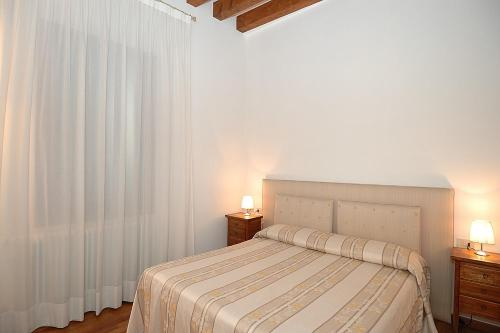 A bed or beds in a room at Corte Nova