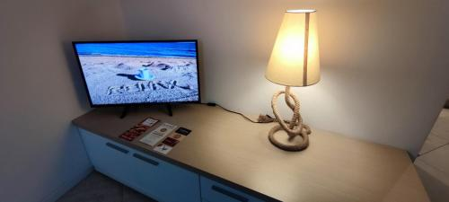 A television and/or entertainment centre at Dolce Riva Downtown apartment