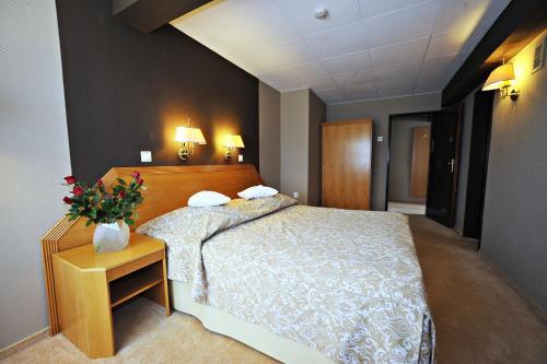 Łóżko lub łóżka w pokoju w obiekcie Hotel Sport