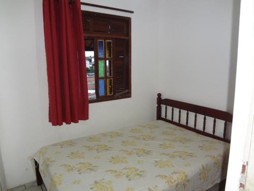 A bed or beds in a room at Condomínio Mar Azul