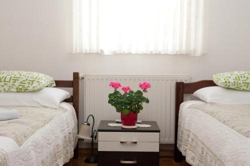 Кровать или кровати в номере Apartment Urbana Vila