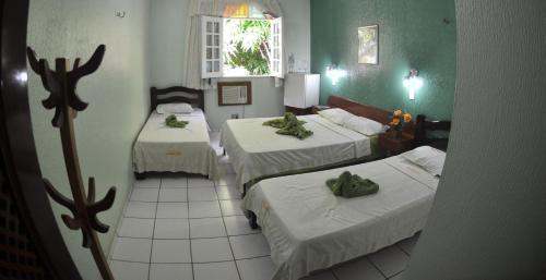 A bed or beds in a room at Hotel Dunas De Paracuru