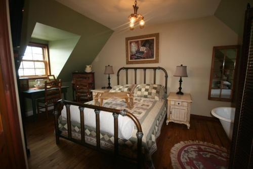 Un ou plusieurs lits dans un hébergement de l'établissement Gite Nature et Confiture