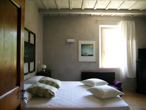 Letto o letti in una camera di Tuttaterra