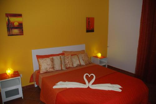 A bed or beds in a room at B&B Eolo