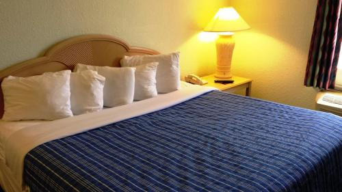 A bed or beds in a room at Cocoa Beach Suites Hotel