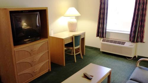 A television and/or entertainment center at Cocoa Beach Suites Hotel