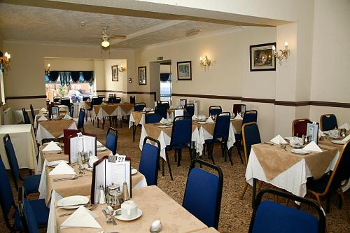 A restaurant or other place to eat at Channel View Hotel