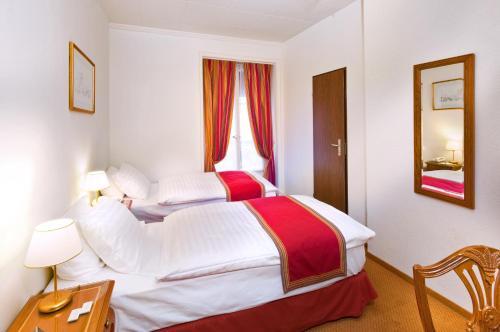 Ein Bett oder Betten in einem Zimmer der Unterkunft Hotel AlaGare
