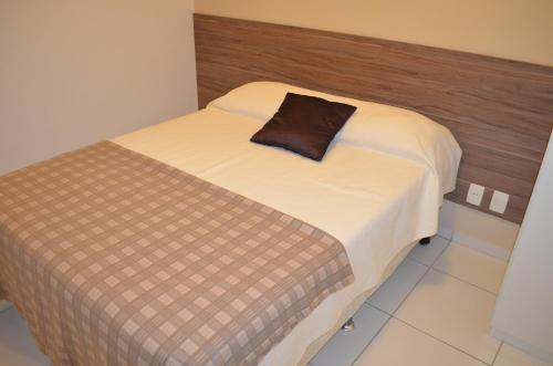 A bed or beds in a room at Apartamento Costa Azul