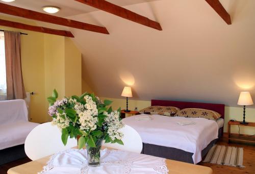 Postel nebo postele na pokoji v ubytování Penzion Kremenisko