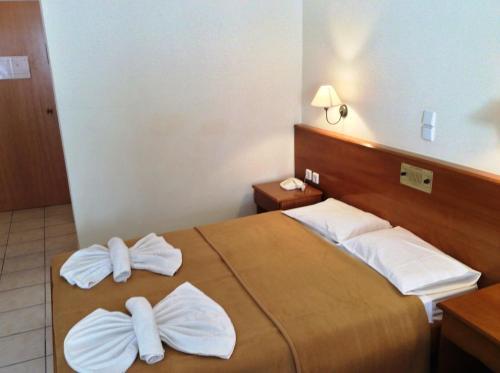 Ένα ή περισσότερα κρεβάτια σε δωμάτιο στο Andreolas Beach Hotel