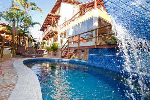 The swimming pool at or near Pousada Safira do Morro