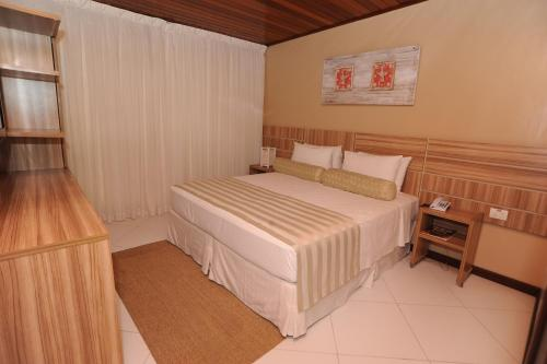 A bed or beds in a room at Pousada Safira do Morro