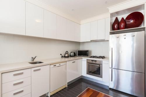 A kitchen or kitchenette at Piper - Beyond a Room Private Apartments