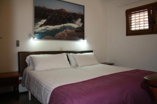 A bed or beds in a room at Apartamentos Mayagüez - Adults Only
