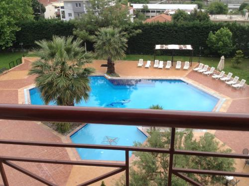 A view of the pool at Hotel Orfeas or nearby