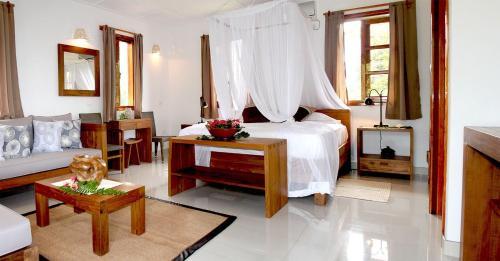 Кровать или кровати в номере Domaine Les Rochers