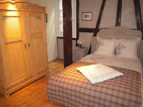 A bed or beds in a room at Appartement Le Chez Soi Riquewihr