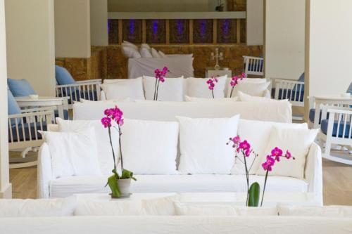 A bed or beds in a room at Sentido Sandy Beach Hotel & Spa