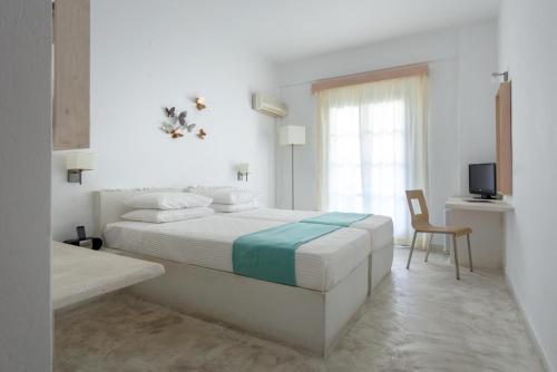 Een bed of bedden in een kamer bij Hotel 28