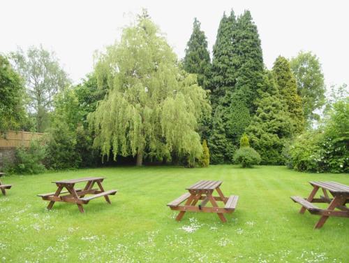 A garden outside Wimblehurst Hotel