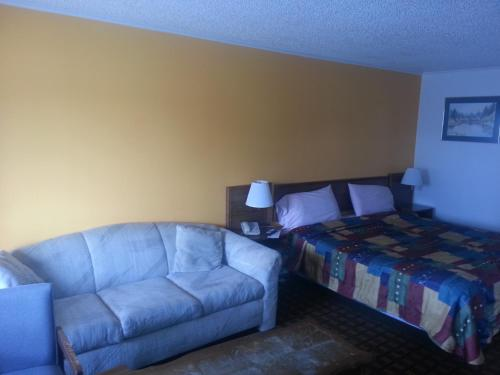 A bed or beds in a room at XIT Ranch Motel