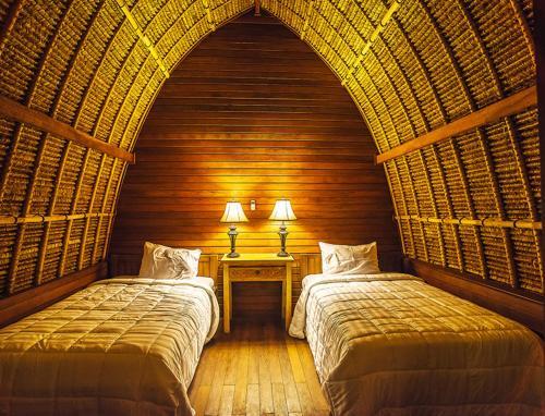 Un ou plusieurs lits dans un hébergement de l'établissement Sukanusa Luxury Huts